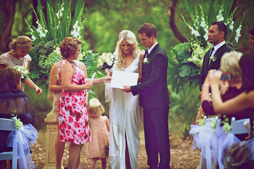 "Margaret River's ""best celebrant"" presents a marriage certificate"