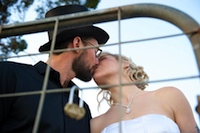 newlyweds attach a love heart shaped padlock to the gate at margaret river heartland