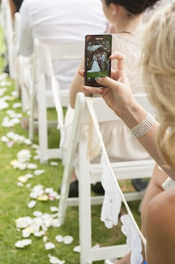 viewing a wedding through a pixelated screen