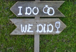 wedding sign pointing to the ceremony and reception