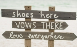 beach wedding sign asking guests to remove shoes