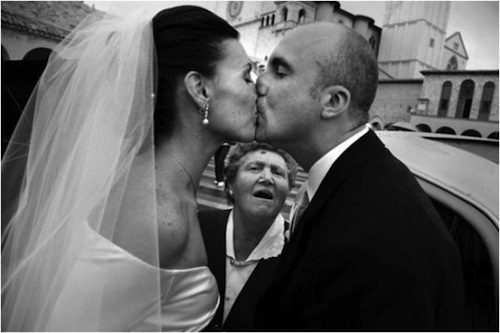 your wedding photographer can relax - I will not photobomb the first kiss