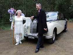 the couple chose a vintage car for their wedding